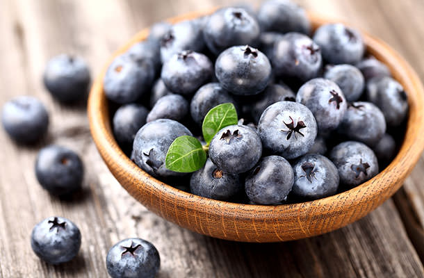bigstock-Ripe-blueberry-in-a-wooden-pla-44027494