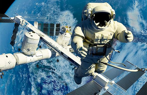 bigstock-The-astronaut-on-a-background--49736744