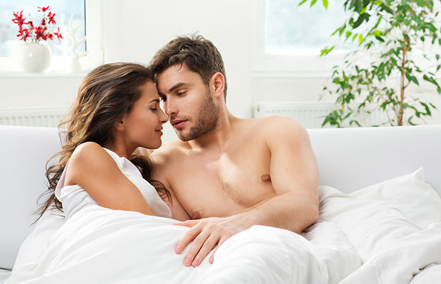 Young adult couple in bedroom