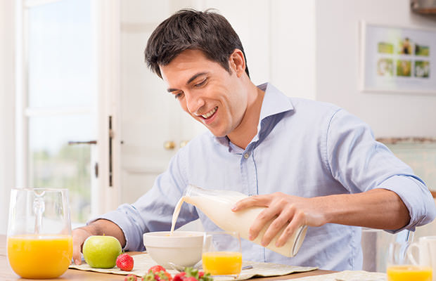 bigstock-Happy-Young-Man-Pouring-Milk-I-48108911