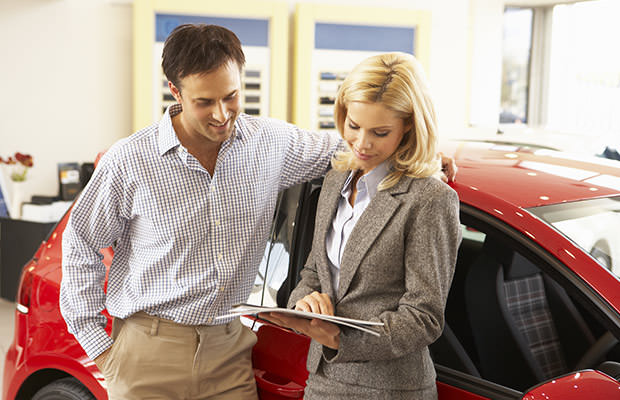 bigstock-Man-buying-new-car-67333795