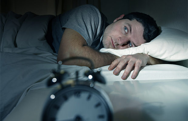bigstock-Man-In-Bed-With-Eyes-Opened-Su-57346916