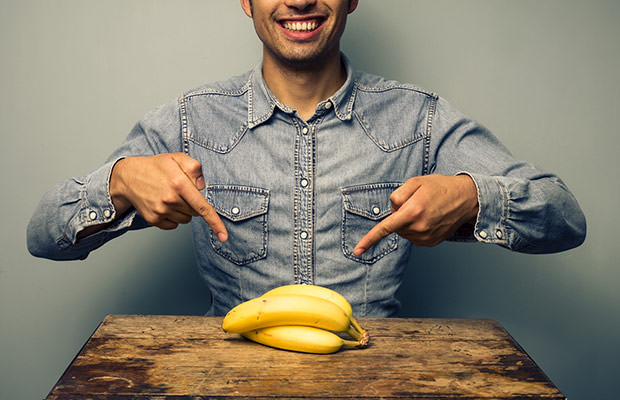 bigstock-Man-Pointing-At-Bananas-At-Old-57603566