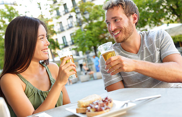 bigstock-Couple-eating-tapas-drinking-b-80792330