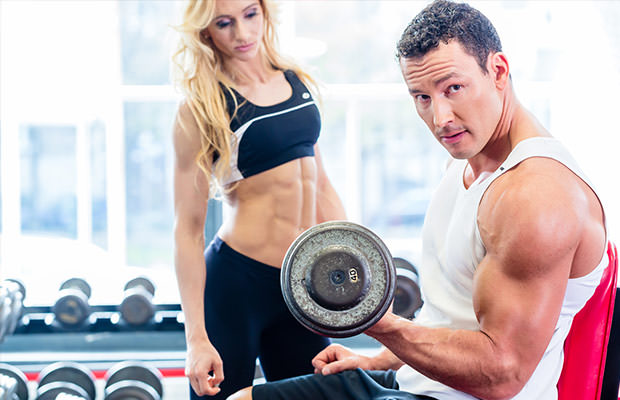 bigstock-Couple-in-fitness-gym-with-dum-80614703