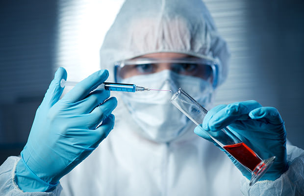 bigstock-Researcher-Preparing-A-Syringe-76111466