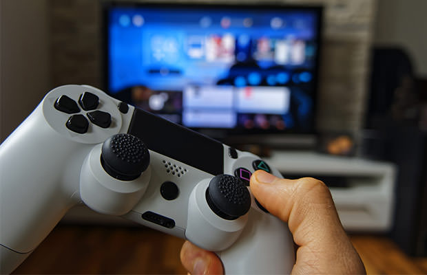 bigstock-Hand-with-Gamepad-81464744