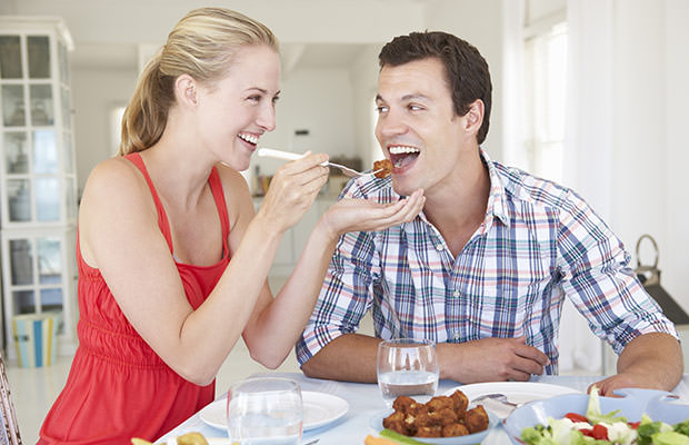 bigstock-Young-Couple-Enjoying-Meal-At--91239773