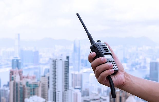 bigstock-hand-holding-walky-talky-with--96472604