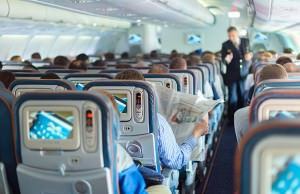 bigstock-Steward-and-passengers-on-comm-110677163