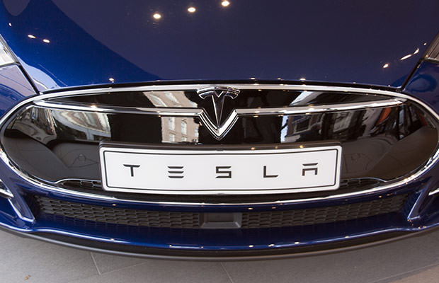bigstock-Tesla-Car-In-A-Showroom-In-Ams-106016768