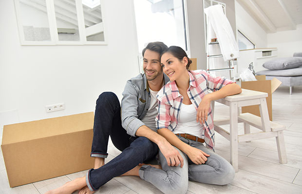 bigstock-Young-couple-moving-into-new-h-108132533