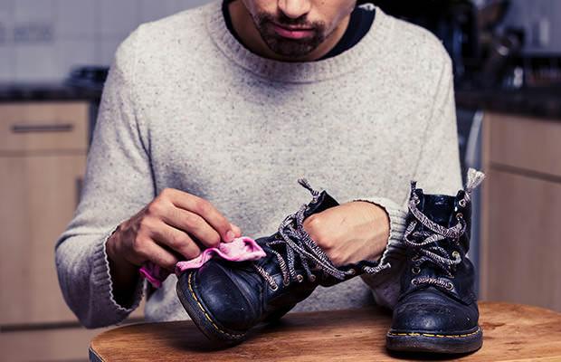 bigstock-Man-Is-Polishing-His-Boots-57902099