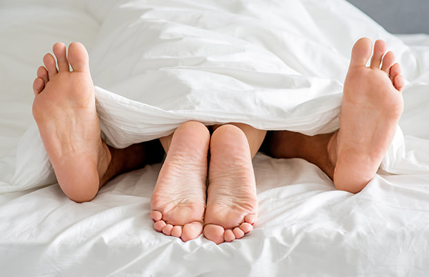 bigstock-Close-up-Sweet-Couple-Feet-Sol-74080660