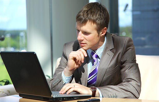 bigstock-Businessman-working-on-laptop--13867364