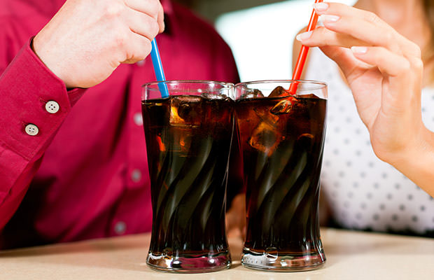 bigstock-Couple-drinking-soda-in-a-bar--25701170