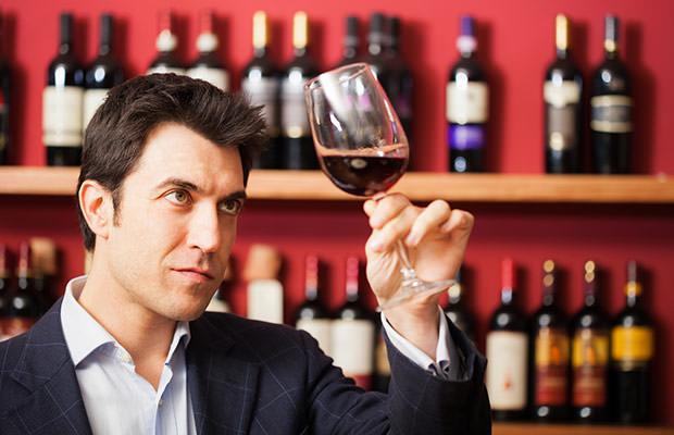 bigstock-Man-tasting-a-glass-of-red-win-75324970
