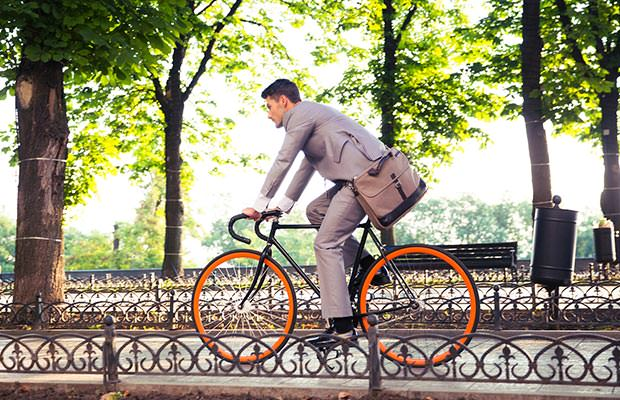 bigstock-Businessman-riding-bicycle-to--97836794
