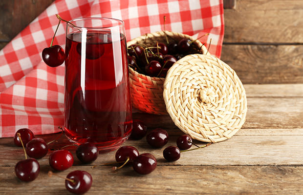 bigstock-Glass-of-cherry-juice-on-woode-98993177