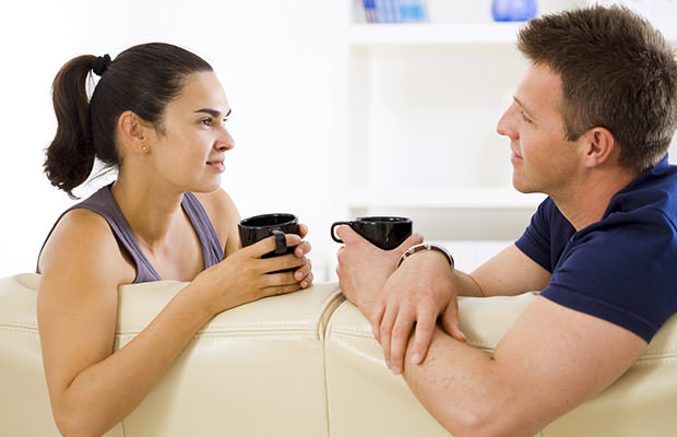 Couple having a conversation on the sofa
