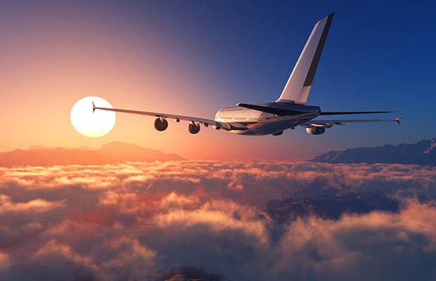 bigstock-Passenger-plane-above-the-clou-85177178