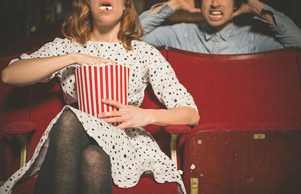 bigstock-Woman-Annoying-Man-In-Cinema-B-87828788