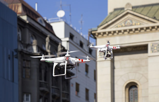bigstock-Two-Drone-To-Fly-In-The-City-83844149