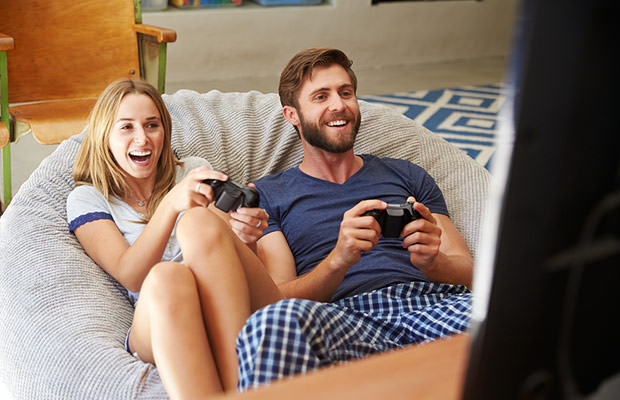bigstock-Young-Couple-In-Pajamas-Playin-86867837